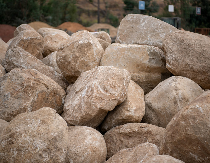 Desert Sand landscape boulders pile in rock yard