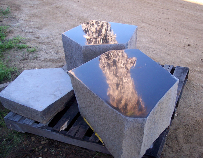Basalt Polished Top Stone stools on pallet in rock yard 1