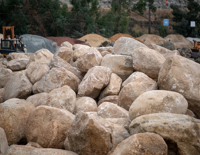 Desert Sand landscape boulders pile in rock yard 2