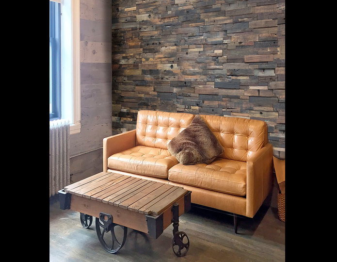 realstone systems reclaimed wood multi colored panels in industrial office