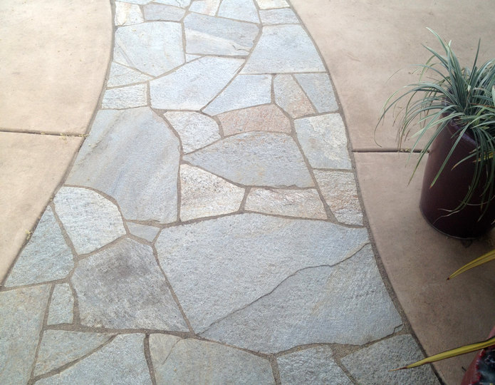 Silver Quartzite natural flagstone patio pavers installed in walkway