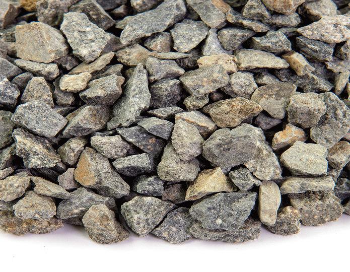 Crushed construction grade stone in bulk at rock yard 2