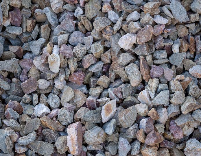 Indian Gold crushed stone rock in bulk at rock yard