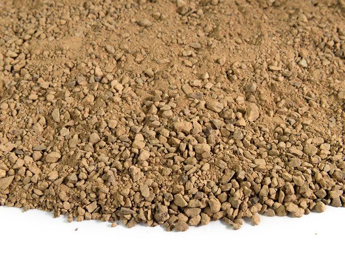 Golden Fawn decomposed granite fines in bulk at rock yard closeup texture