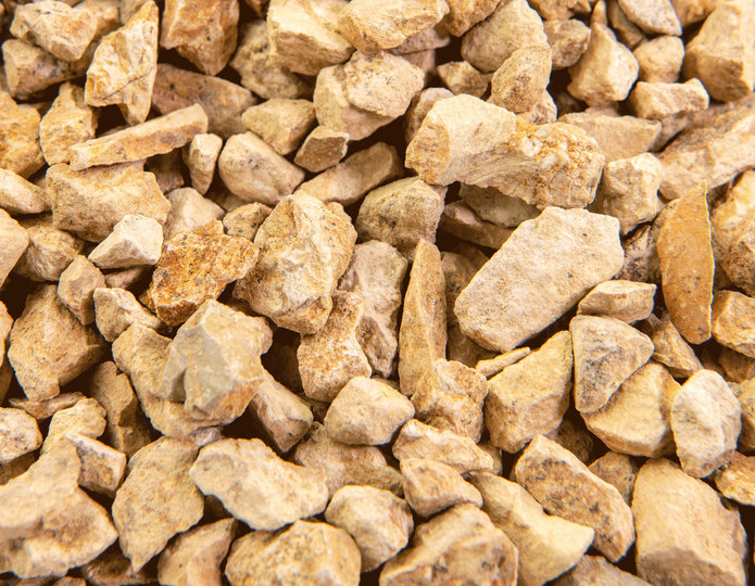 California Gold crushed stone rock closeup texture