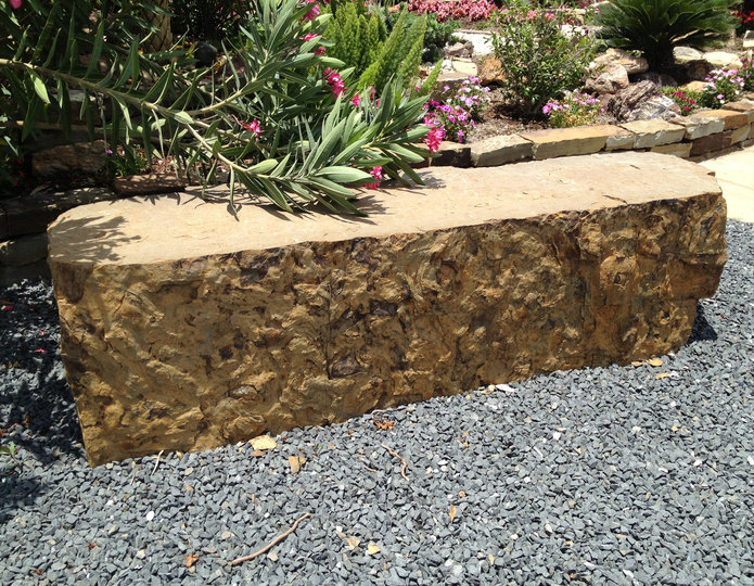 Browns ranch bench landscape boulder installed in a landscaping design