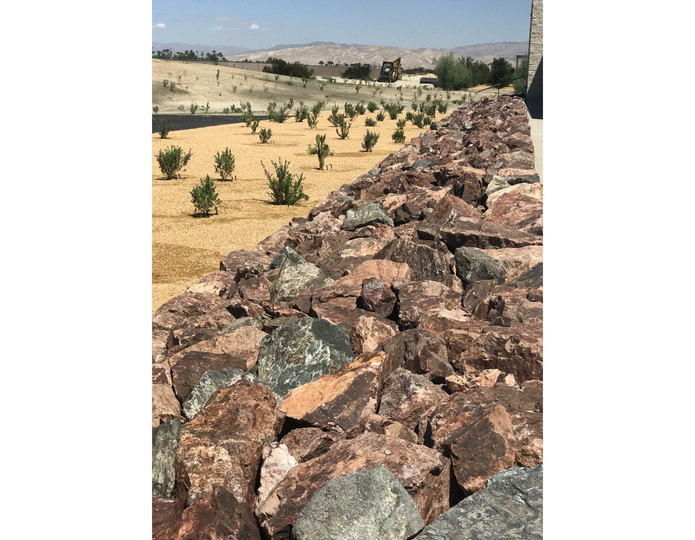 Southwest Brown landscape boulders with decomposed granite in yard