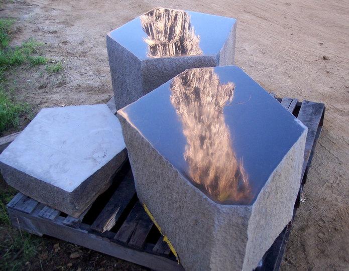 Basalt Polished Top Stone stools on pallet in rock yard 1
