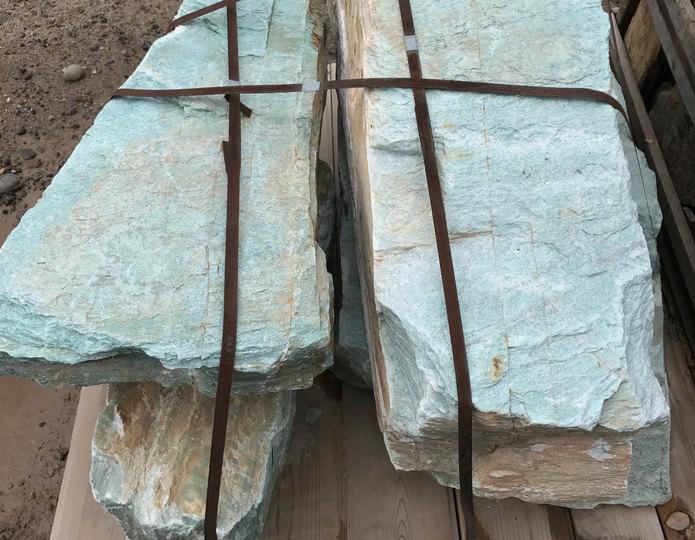 Turquoise landscape boulders in rock yard 2