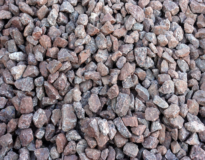 Indian Red crushed stone rock in bulk at rock yard