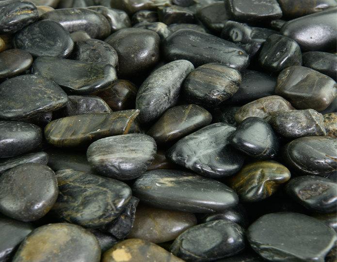 Black Polished decorative pebble in bulk at rock yard