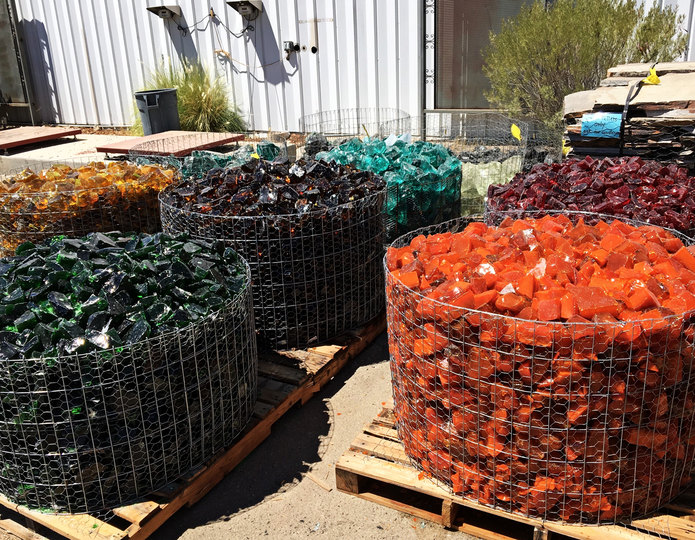 Crushed colored landscape glass in bulk at rock yard