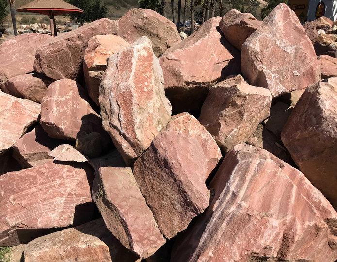 Pale sunset boulder in bulk at rock yard