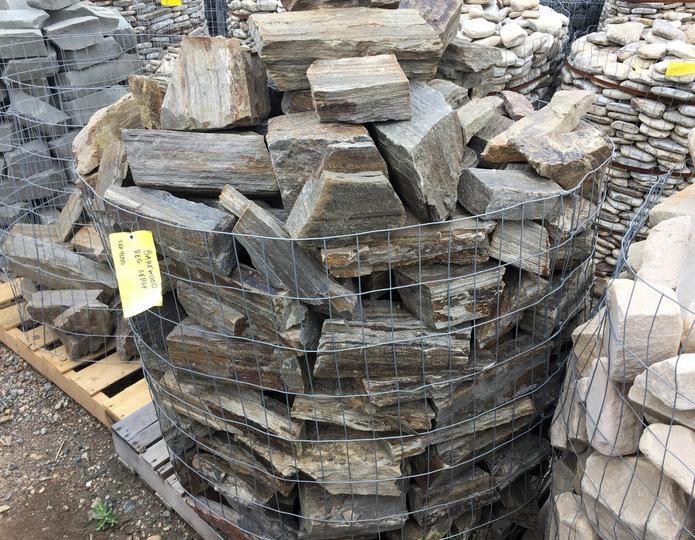 Barkwood ledgestone in gabion basket at stone yard