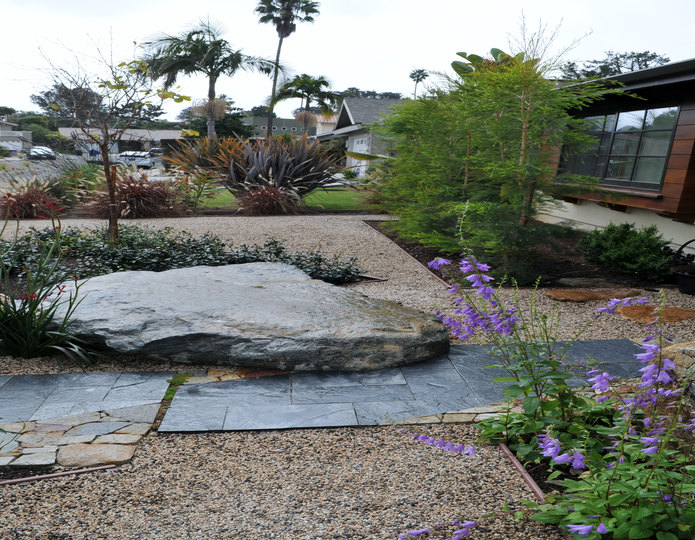 Chamois Beige crushed stone rock in installed in front yard with boulders