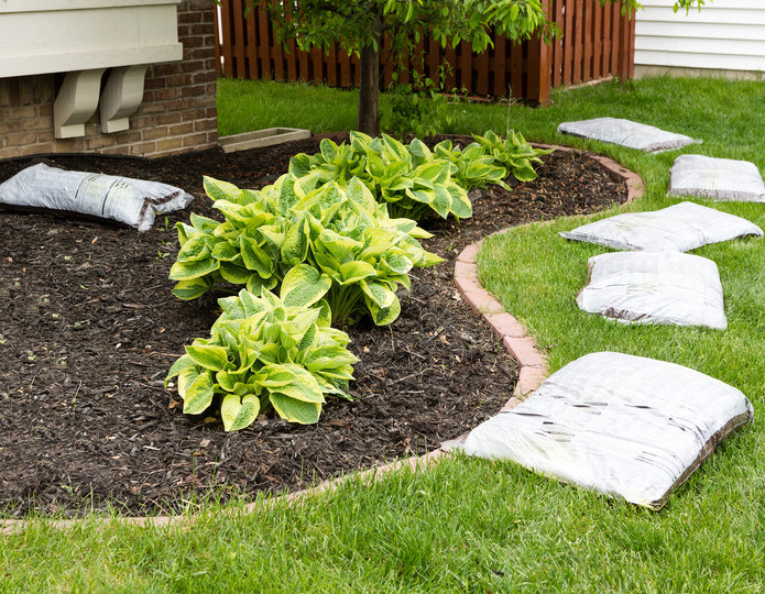 Landscape fabric weed barrier installed under mulch