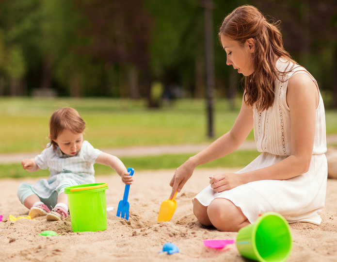 Mother and daughter playing on premium playground sand