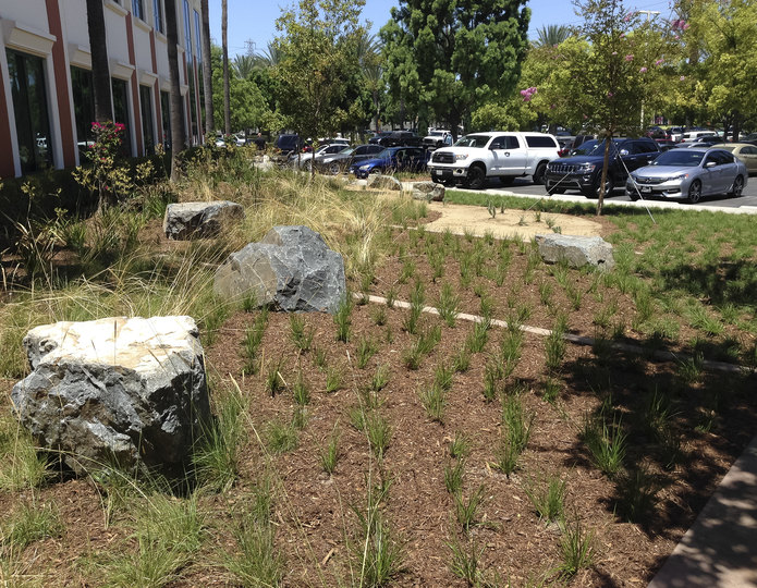 Cresta gray boulders with mulch in front of commercial building