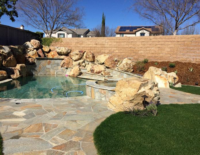 Gold Quartzite natural flagstone patio pavers around pool in backyard