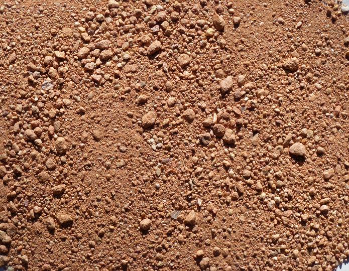 Adobe Sunset decomposed granite fines in bulk at rock yard