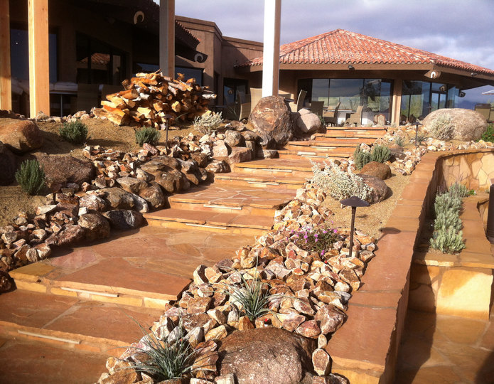 Arizona Buckskin natural flagstone patio pavers in front yard with boulders and crushed rock