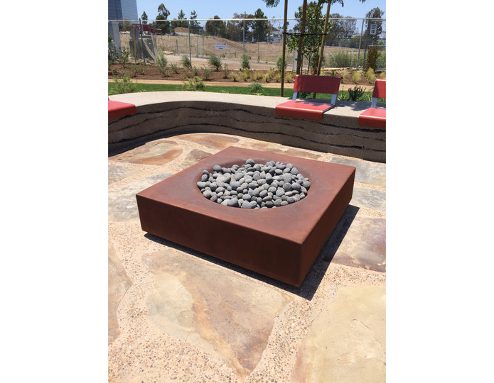 Black Mauna Loa pebble in fire pit at Summit Rancho Bernardo designed by LdG Landscape Architects
