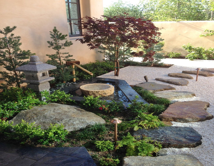 Smokey White Ice crushed stone rock installed around zen garden and fountain