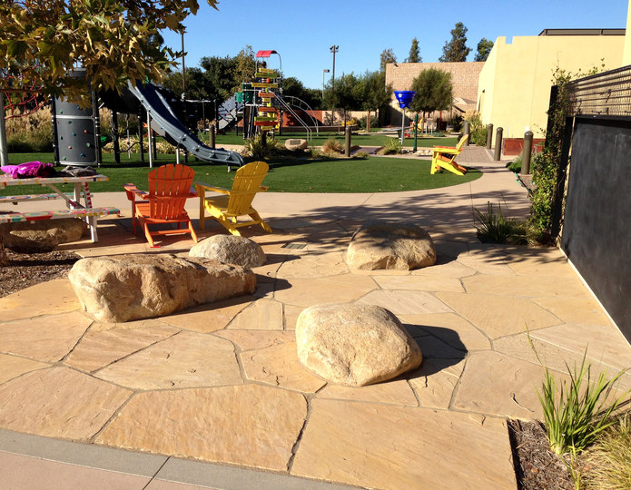 Arizona Buff natural flagstone patio pavers at park with boulders
